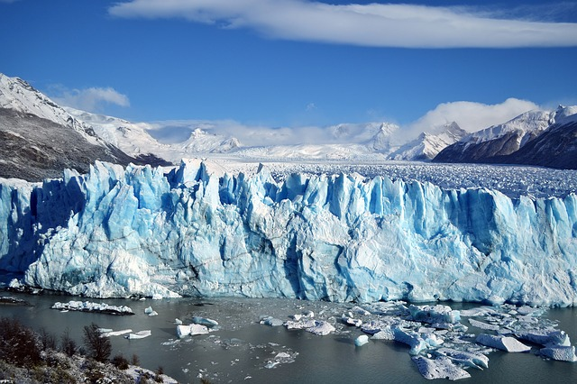 What is the difference between an iceberg and glacier?