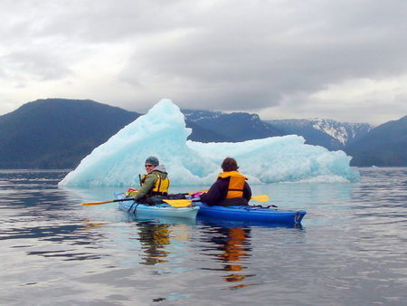 Kayaking Near Alaska Glaciers & Icebergs The Inside Passage near Juneau is world-renowned for its scenery, its wildlife, and its jaw-dropping ice walls. Glaciers and icebergs abound inside of the fjords and inlets, and experiencing them is altogether unforgettable. On our customizable Alaskan cruises, guests can watch coastal glaciers break apart and crash into the bay in a process known as calving. The sound is so loud that many mistake it for thunder or an explosion. You can also get up close and personal with the ice by getting out on the water and kayaking around the floes. We also love collecting glacier ice to put in your dinner drinks. If you have never kayaked before, there are some considerations. Kayaks are small, low to the water crafts that can be difficult to maneuver. A minimum level of fitness is required. If you are not able to kayak, we have a stable inflatable skiff boat that still lets you explore with the kayakers.
